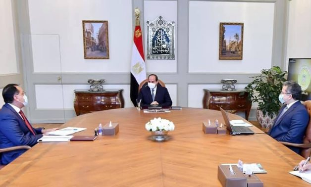 File: President Abdel Fattah El Sisi,prime minister Mostafa Madbouly and minister of tourism and antiquites Khaled El Enany.