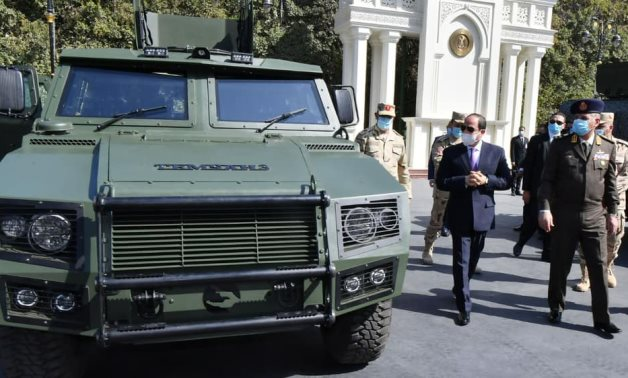President Abdel Fatal al-Sisi with a sample of an armored vehicle that was developed by the Egyptian Armed Forces – Press Photo