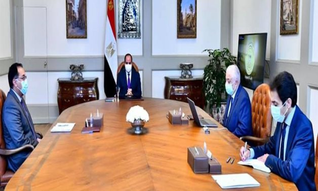 President Abdel Fatah al-Sisi in a meeting with Prime Minister Mostafa Madbouli and Minister of Education and Technical Education Tarek Shawky on February 14, 2021. Press Photo