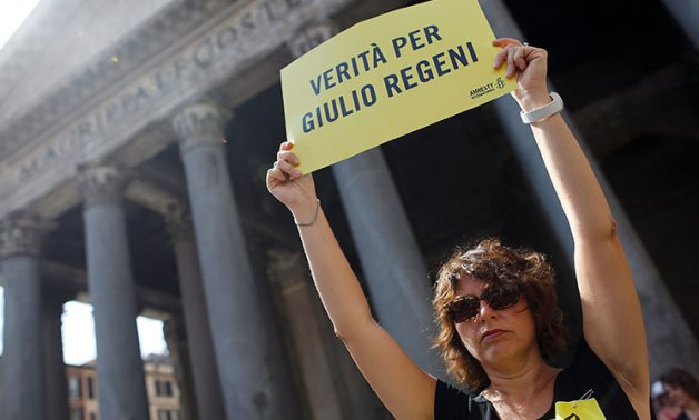 """FILE - An international activist holds a placard reading """"truth for Giulio Regeni"""" in Rome - Reuters"""