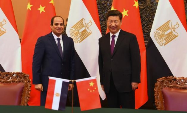 FILE - Egyptian President Abdel Fattah El Sisi (L) meets with his Chinese counterpart (R), President Xi Jinping - press photo