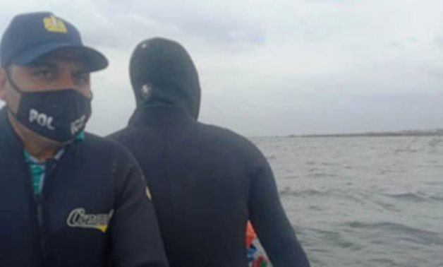 Divers looking for the bodies in the capsizing accident in Lake Maryout, Alexandria on February 23, 2021.