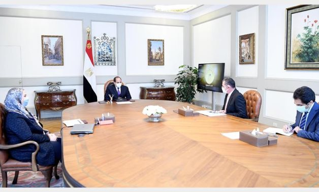 Egyptian President Abdel Fattah El Sisi meets with Minister of Social Solidarity Nevin El-Qabbaj and the president's advisor for financial affairs, Mohamed Amin- Presidency