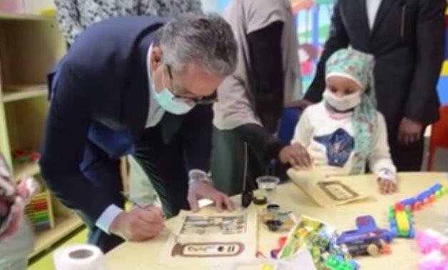 Khaled el-Enany, Egypt's tourism & antiquities minister visits children at Shifa El-Orman Hospital in Luxor - Scrteenshot from video