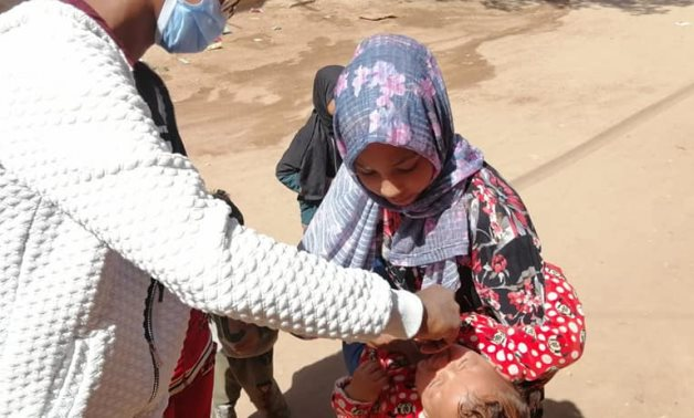 A child being vaccinated against polio in Aswan in March 2021 - Health Ministry branch in Aswan