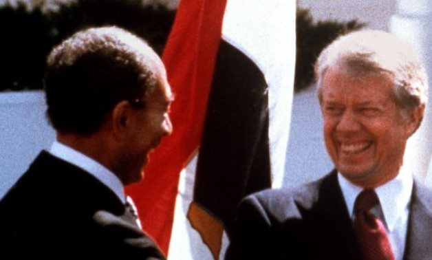 Egyptian President Anwar Sadat, left, US President Jimmy Carter, right, during the latter's visit to Egypt in 1979 - (photo credit: AP/Bob Daugherty/File)