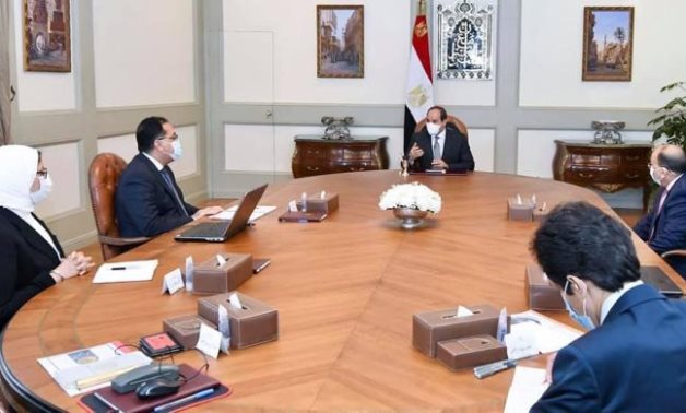 President Sisi in meeting with PM, and three ministers to follow up on 'Decent Life' initiative on March 7, 2021 - Press Photo