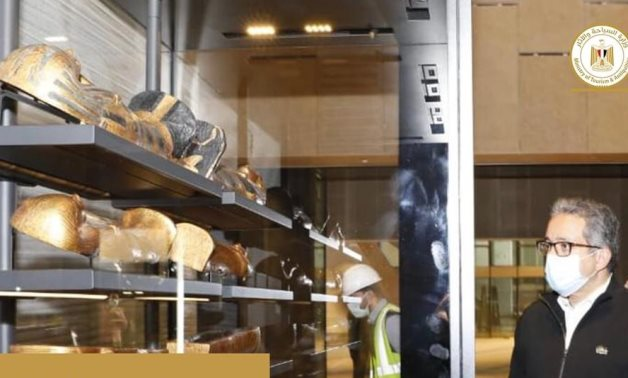 File: Egypt's Minister of Tourism and Antiquities Khaled El Enany witnessed the placement of the first pieces of the treasures of King Tutankhamun in thei display vitrines in the Grand Egyptian Museum.