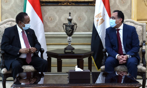 Egyptian Prime Minister Moustafa Madbouli meets with his Sudanese counterpart Abdalla Hamdok who paid Egypt an official visit on Thursday- press photo