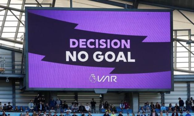 General view of the big screen displaying the VAR decision REUTERS/Phil Noble