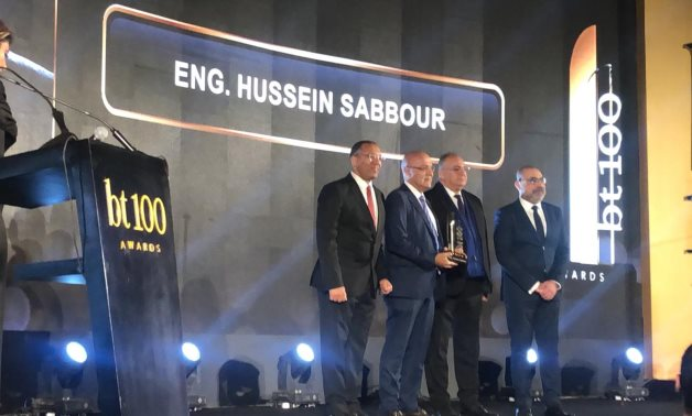 Youm7 editor-in-chief Khaled Salah hands award to the son of late engineer Hussein Sabbour – Egypt Today