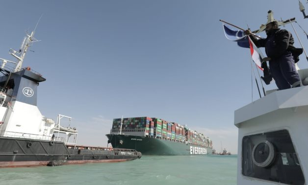 Panama-flagged Ever Given ship is pulled by giant tugboats to harbor in the Great Bitter Lakes in Ismailia- press photo