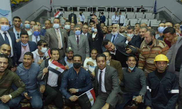 The Egyptian Suez Canal Authority's staff honored by Admiral Rabie for their efforts in refloating Ever Given vessel- press photo