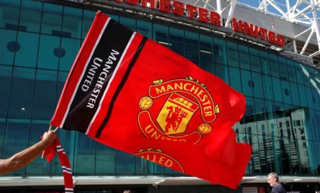 Manchester United logo, Reuters
