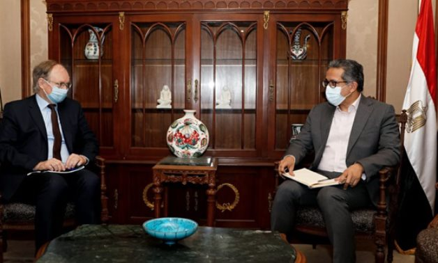 Egypt's Min. of Tourism & Antiquities Khaled el-Enany [R] during his meeting with EU Ambassador to Cairo Christian Berger on April 15 - Press photo