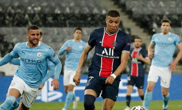 Mbappe in action against Man City, Reuters