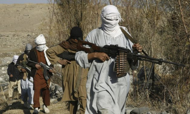 FILE - Taliban fighters pose with weapons in an undisclosed location in Nangarhar province in this December 13, 2010 picture. REUTERS/Stringer