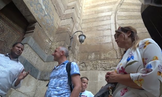 Liechtenstein's Prime Minister Adrian Hasler listens to an Egyptian guide at a historic mosque in Cairo - Still image of Haggagovic video