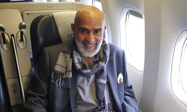 Ashraf El-Saad publishes a photo on his Twitter in the plane while returning from London to Cairo