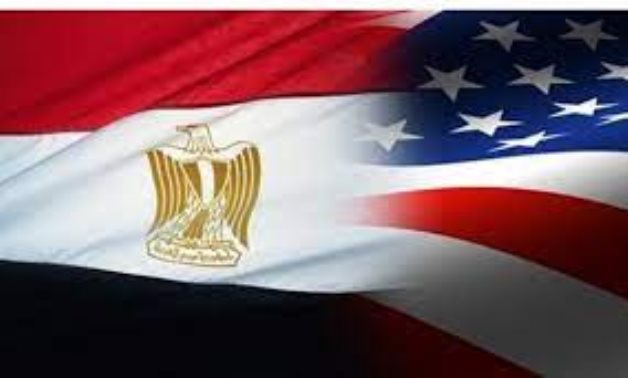 FILE – Egyptian and U.S. flags