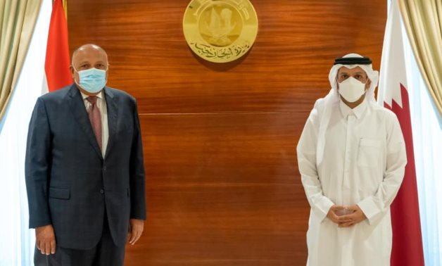 Minister of Foreign Affairs Sameh Shoukry with the Deputy Prime Minister and Minister of Foreign Affairs of Qatar, Sheikh Mohammed bin Abdulrahman Al-Thani in Doha on Monday- press photo