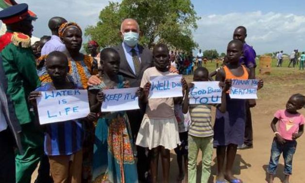 Minister Mohamed Abdel Aty posing with children while inaugurating an underground water treatment plant built by Egypt in South Sudan's Lemon Mountain on June 23, 2021. Press Photo