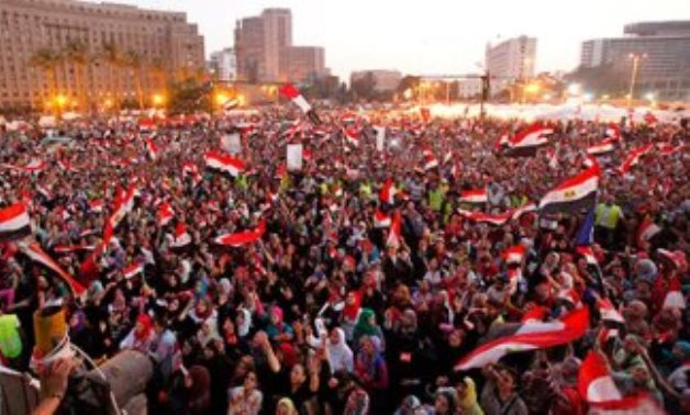 FILE – Masses protesting in Tahrir Square during June 30 Revolution in 2013