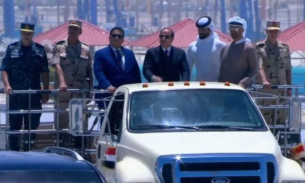 Sisi accompanied Abu Dhabi Crown Prince Mohammed bin Zayed and Head of Libya's Presidential Council Menfi in his tour at the 3 July Base – Screenshot/Ten TV