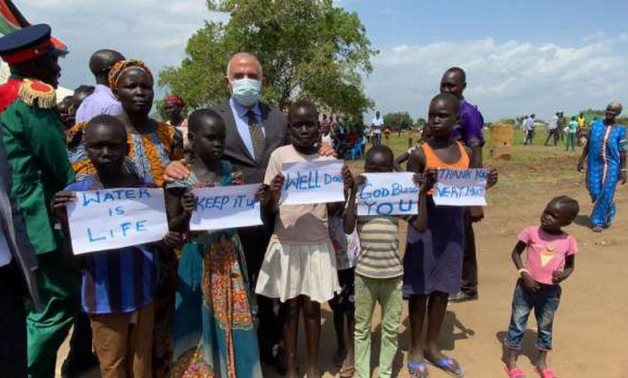 FILE - Minister of Irrigation and Water Resources Mohamed Abdel Aty posing with children while inaugurating an underground water treatment plant built by Egypt in South Sudan on June 23, 2021. Press Photo
