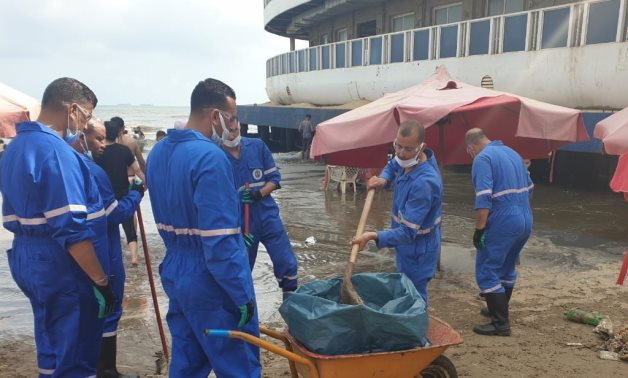 A 1,000-meter-sized oil spill on Monakh beach in Port Said- press photo