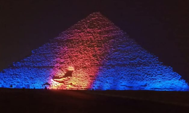 Egypt's Giza pyramids and Saladin Citadel lit up in blue and orange to celebrate the World Hepatitis Day on Wednesday- press photo