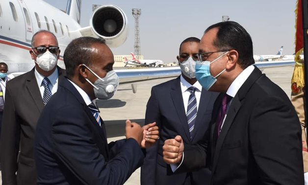 Egyptian Prime Minister Moustafa Madbouli receives his Somali counterpart Mohamed Hussein Roble at the Cairo International Airport- press photo