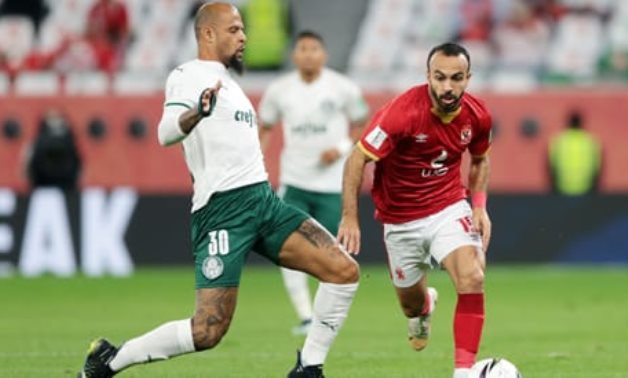 Al Ahly's Mohamed Afsha in action with Palmeiras' Felipe Melo REUTERS