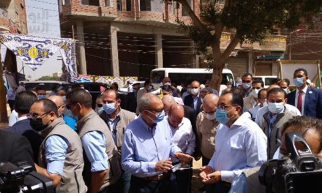 Egypt's PM during an inspection tour in Shebin El Qanatir township of Qalubiya governorate.