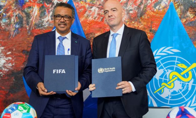 File - WHO Director-General Dr. Tedros Adhanom Ghebreyesus and FIFA President Gianni Infantino