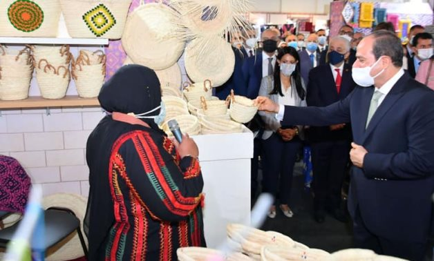 President Abdel Fattah El Sisi inspects the Turathna (our heritage) Exhibition for handicrafts on October 9, 2021- press photo