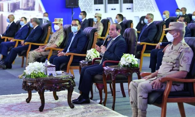 Egypt's President Abdel Fattah El-Sisi speaks during the inauguration ceremony of housing units in Giza's 6th of October City - Presidency