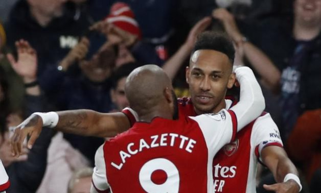 Aubameyang and Lacazette celebrate Arsenal's second goal in the game, Reuters
