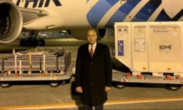 Egyptian Ambassador to Budapest Mohamed al-Shenawy posing with AstraZeneca vaccine doses while shipped from Hungary to Egypt on October 26, 2021.
