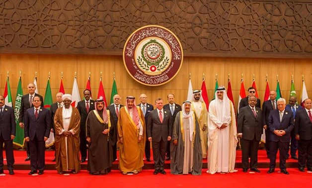 Caption Arab leaders and head of delegations pose for a group photograph during the 28th Ordinary Summit of the Arab League at the Dead Sea, Jordan March 29, 2017- Reuters