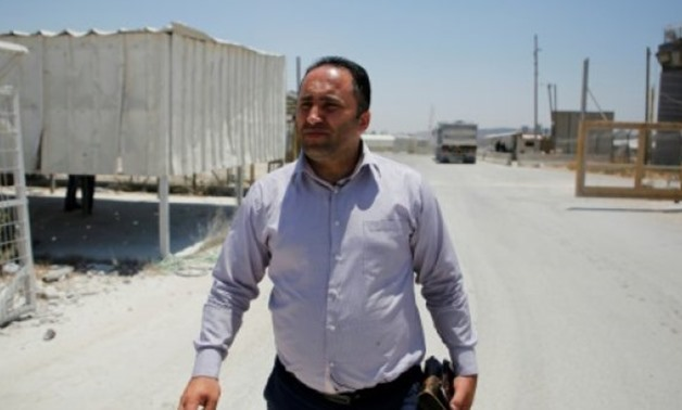 © AFP | Palestinian activist Issa Amro arrives for an Israeli military hearing near the West Bank city of Ramallah