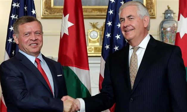 US Secretary of State Rex Tillerson (R) shakes hands with Jordanian King Abdullah II before their working luncheon at the State Department in Washington, DC, April 4, 2017 - REUTERS