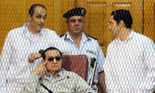 Gamal Mubarak (left), former President Mohamed Hosni Mubarak (middle) and Alaa Mubarak (right) - File photo