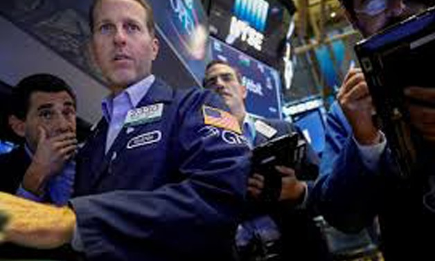 Traders work on the floor of the New York Stock Exchange (NYSE) in New York, U.S., August 25, 2017. REUTERS/Brendan McDermid