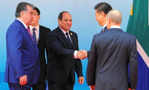 President Sisi shakes hand with his Chinese counterpart Xi Jinping at the Dialogue of Emerging Market and Developing Countries in Xiamen - Xinhua