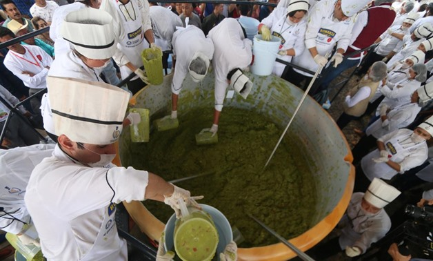 Volunteers from a culinary school mix mashed avocados as they attempt to set a new Guinness World Record for the largest serving of guacamole in Concepcion de Buenos Aires, Jalisco, Mexico September 3, 2017. REUTERS/Fernando Carranza