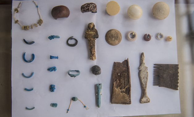 ornaments recovered at the site of a newly-uncovered ancient tomb for a goldsmith dedicated to the ancient Egyptian god Amun, in the Draa Abul Naga necropolis on the west bank of the ancient city of Luxor, which boasts ancient Egyptian temples and burial