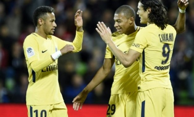 AFP/File / by Kieran CANNING | (From L) Paris Saint-Germain's Neymar, Kylian Mbappe and Edinson Cavani celebrate a goal during their French Ligue 1 match against Metz (FCM), at the Saint-Symphorien stadium in Longeville-les-Metz, on September 8, 2017
