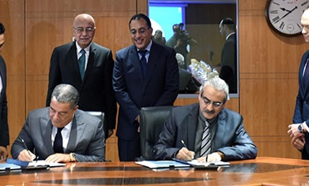 PM Sherif Ismail and Minister of Housing Mostafa Madbouly while witnessing the signing of the agreement- File Photo