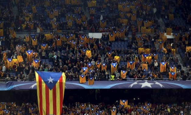 Barcelona fans with Catalonia flags - Reuters
